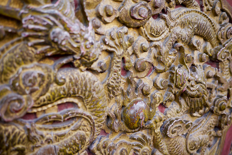 Dragon adornments and carvings on the Forbidden City walls
