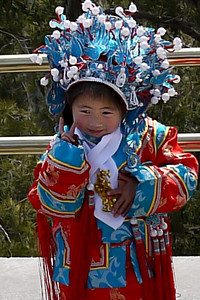 Little Chinese girl dressing up at Jingshan Park, overlooking the Forbidden City in Beijing, China.