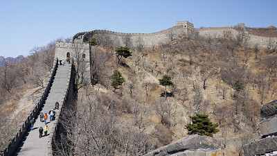 The Great Wall of China cresting the hilltops nearby.