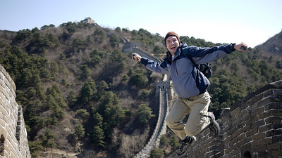 Pete jumping at the Great Wall of China