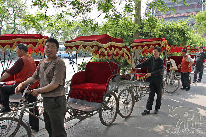 Hutong drivers waiting for tourist to arrive for a fast-paced tour of the neighborhood