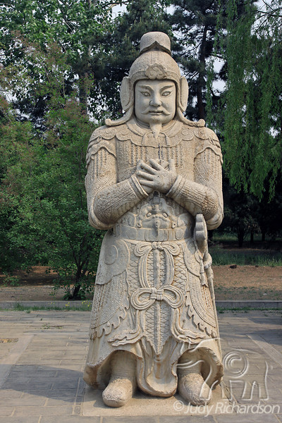 Statue displaying ceremonial dress on the Ming Tombs grounds