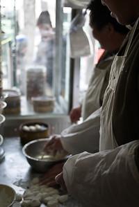 A street food in Beijing hand making delicious vegetable dumplings, China.