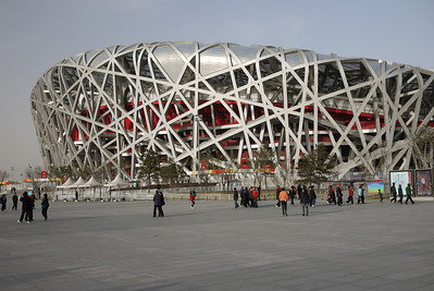 The Bird's Nest in the setting sun in Beijing, China at the Olympic Complex