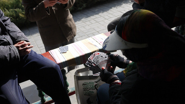Locals playing cards at the Temple of Heaven, Beijing, China.