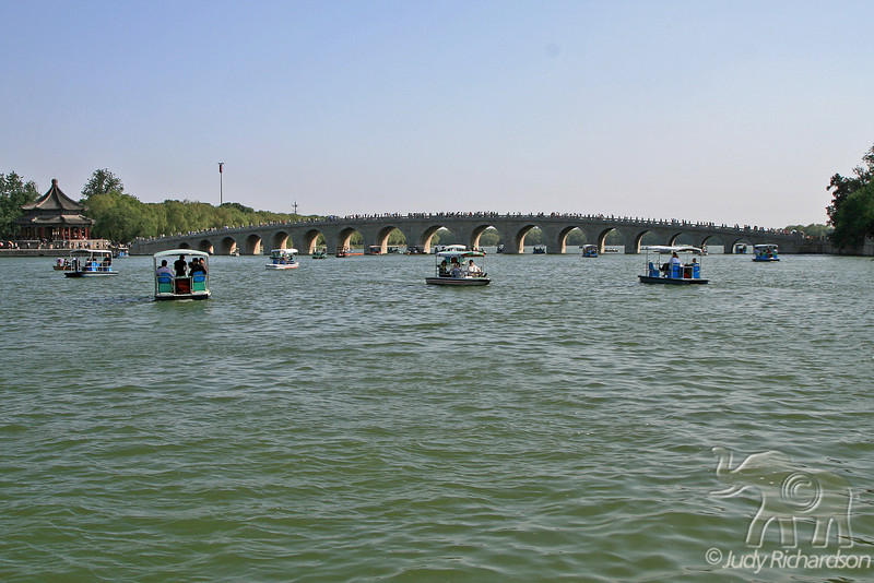 The Seventeen-Arch Pedestrian Bridge and boating activity on lake