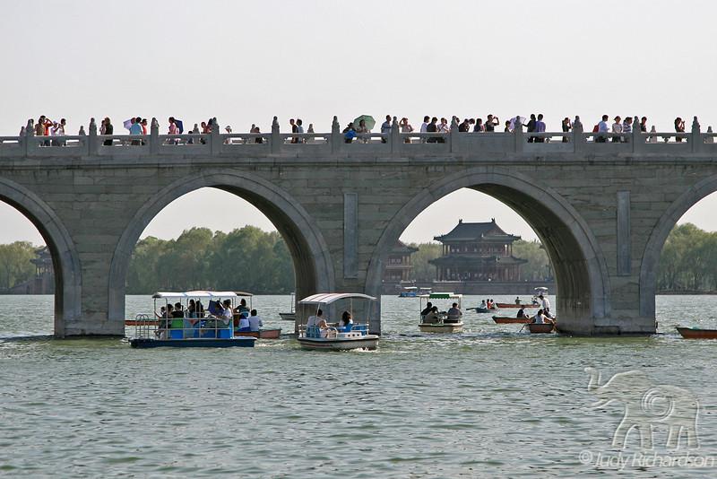 Activity around bridge on lake