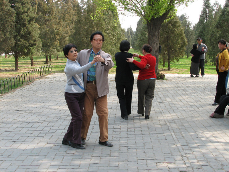 Doing the tango in Tian Tan (Temple of Heaven) Park. There were a bunch of couples there ballroom dancing.