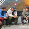 3 pedicab drivers resting near Xizhimen Subway Station Beijing
