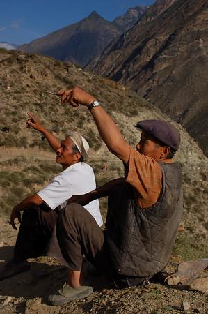 China, Qinghai, Danba: Two villagers showing Yann the shortcut