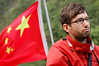 China, Shennong River: Yann and the Chinese flag on the Shennong.