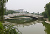 An arched bridge over a canal at the Southwest University of Economics and Finance in Chengdu, Sechuan, China.