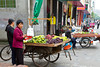Portable fruit stands and vendors on the street in Chengdu, China.
