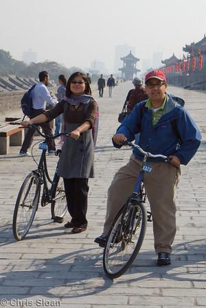 Ling Guan and John Scannapieco bicycling the Xian City Wall at Xian, China (10-22-2009)-10
