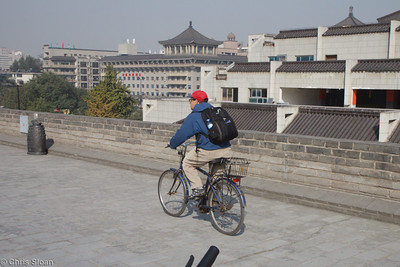 John Scannapieco bicycling Xian City Wall at Xian, China (10-22-2009)-15