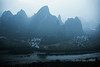 Sleepy morning village at the base of the karst mountains, Xinaggongshan Hill,  Lijiang River, Xingping, Guangxi Province, China