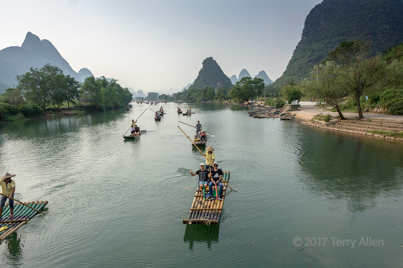 Crowds of Chinese tourists rafting on the Li River, Xingping, Guangxi Province, China