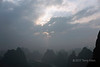 Thick air pollution seen from Xinaggongshan Hill after sunrise, Xingping, Lijaing River, Guangxi, China