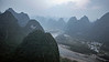 Karst mountains and Lijiang River in thick morning smog, Xingping, Guangxi Province, China