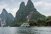 Tour boats cruising by the karst mountains on the Li River, Xingping, Guangxi, China
