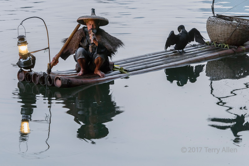 Cormorant fisherman taking a smoke break, Li River, Xingping, Guilin, China