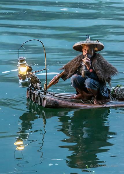 Cormorant fisherman smoking a pipe, Li River, Xingping, Guiling, China