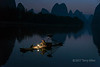 Fishing with cormorants in the early morning, Li River, Xingping, Guiling, China