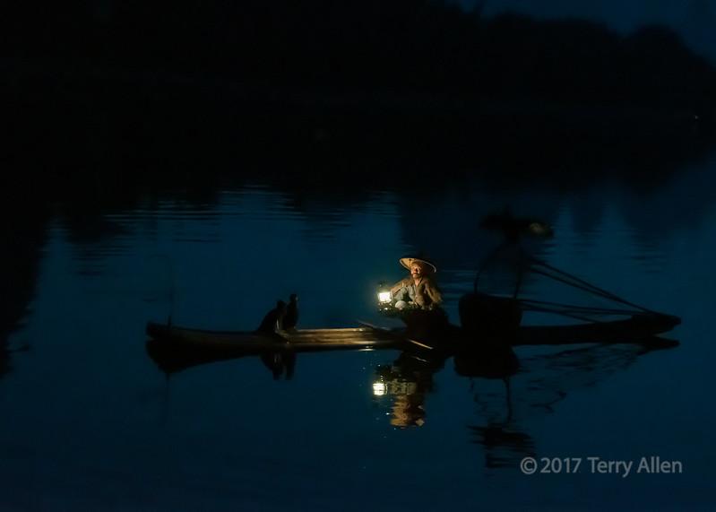 Cormorant fisherman lit by his lamp, Li River, Guilin, China