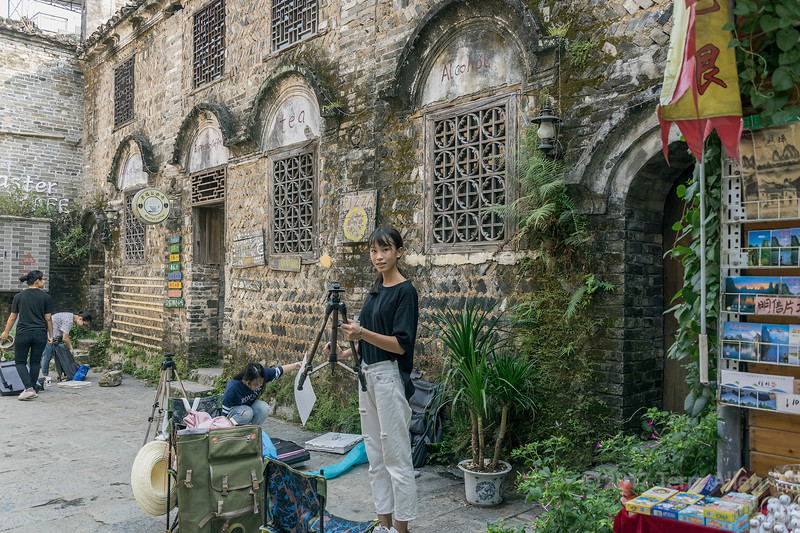 Art students setting up their easels in Xingping Ancient Town, Guangxi Province, China