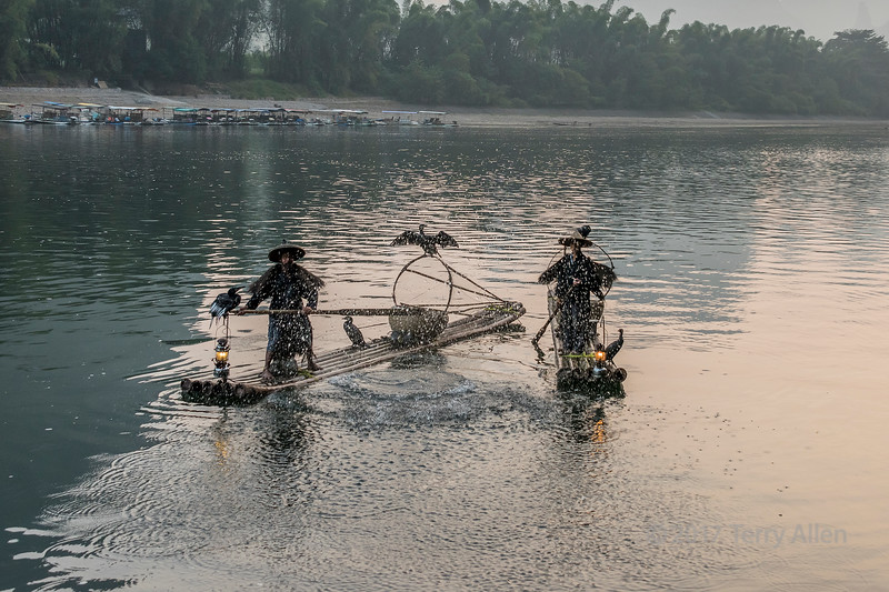 Cormorant fisherman and water splashes on the Li River Xingping, Guilin, China