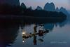 Cormorant fisherman with his three cormorants, Li River, Xingping, Guilin, China