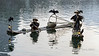 Two cormorant fishermen with their birds on the Li River, Xingping, Guilin, China