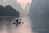 Fishing cormorants drying their wings, Li River, Xingping, Guilin, China