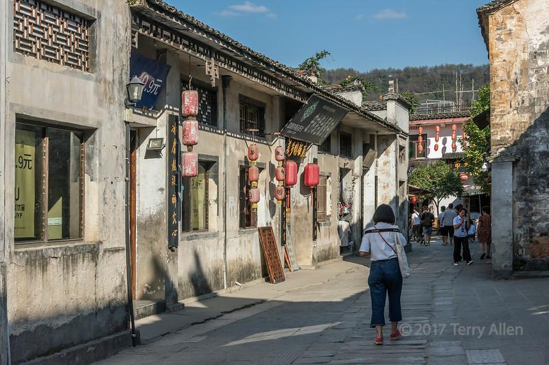 Street scene with tourist, Hongcun Ancient Town, Lixian, Anhui, China