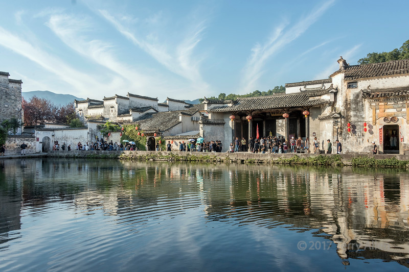 Late day crowds walk around Half Moon Lake, Hongcun Ancient Town, Lixian, Anhui, China