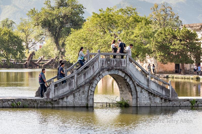 Moon bridge across South (Nanhu) Lake, Hongcun Ancient Town, Lixian, Anhui, China