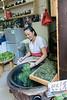 Woman rinsing greens, Hongcun Ancient Town, Lixian, Anhui, China