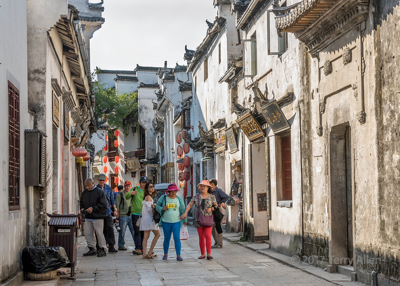 Street scene with photographers, Hongcun, Lixian, Anhui, China