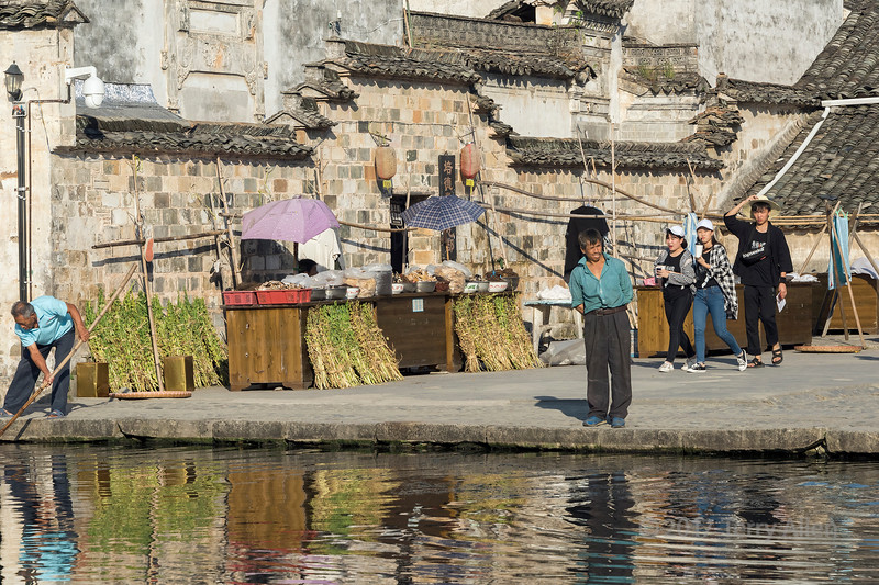 Market stand at the edge of Half Moon Lake, Hongcun Ancient Town, Lixian, Anhui, China
