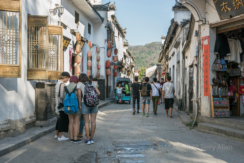 Street scene with Chinese students, Hongcun Ancient Town, Lixian, Anhui, China