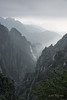 Layers of granite cliffs and deep valley with railway line, Huangshan National Park, Anhui, China