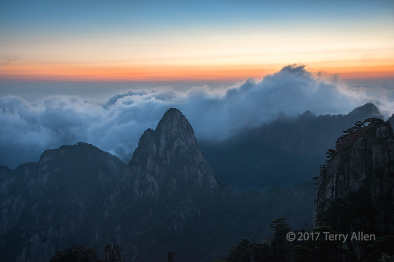 Sunrise and blowing mists at Huangshan, Anhui, China