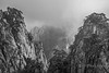 Granite cliffs in the mists, black and white, Huangshan National Park, Anhui, China
