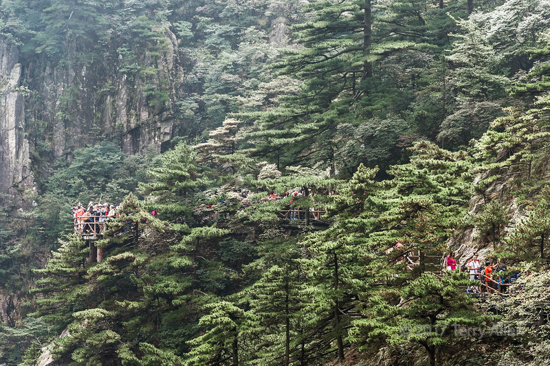 Chinese tourists on a walkway in Huangshan National Park, Anhui Province, China