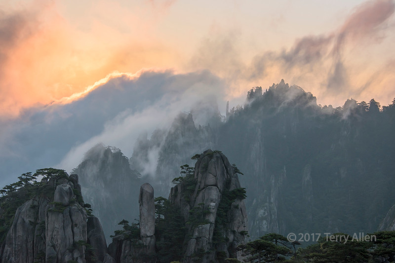 Sun highlighting wind-blown clouds, Huangshan, Anhui, China