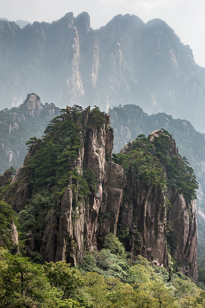 Layers of granite cliffs and vegetation in the Huangshan Mountains, Anhui Province, China