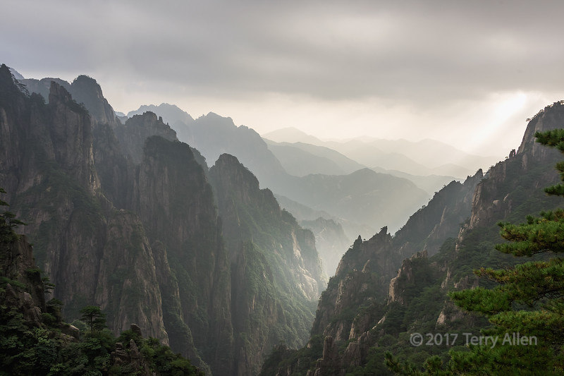Shaft of sun in the Huangshan mountains, Huangshan National Park, Anhui, China