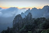Huangshan pillars with blowing mists at sunrise, Anhui, China