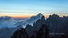 Huangshan sunrise with a stong wind blowing the clouds, Anhui Province, China