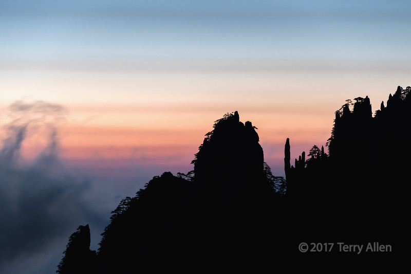 Mists in the strong winds at sunrise, Huangshan, Anhui Province, China